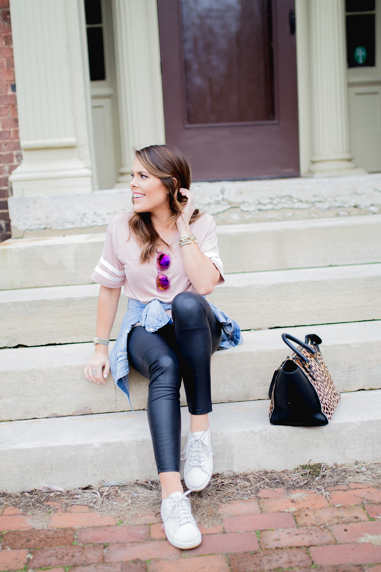 Valentine's Day Outfit Inspiration: Ft. Varsity Tee, Denim Jacket, Nike Sneakers, Clare Vivier, Faux Leather Leggings